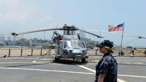 A helicopter stops on the US Navy ship USS Blue Ridge in the Sri Lankan capital Colombo on March 30, 2016. The USS Blue Ridge the command ship of the US Seventh Fleet is in Colombo on a six-day port call.