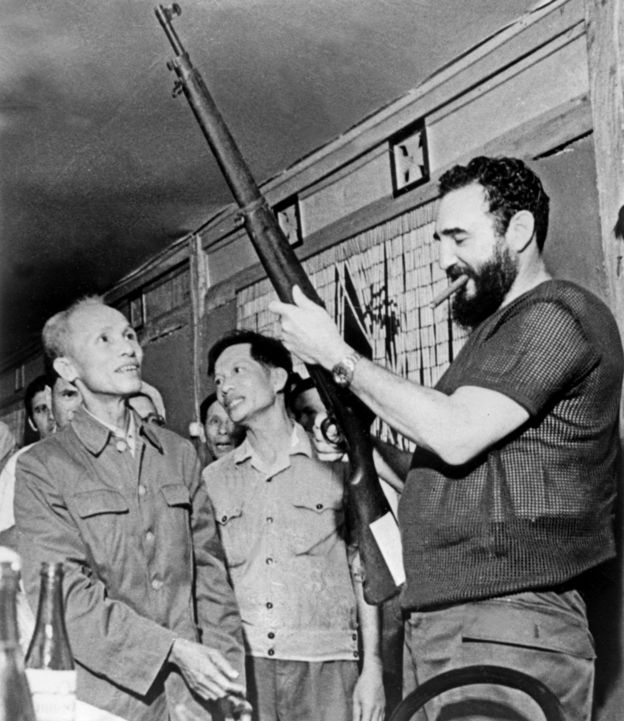 September 1973 shows Cuban president Fidel Castro (R) looking at a rifle during a visit in North Vietnam