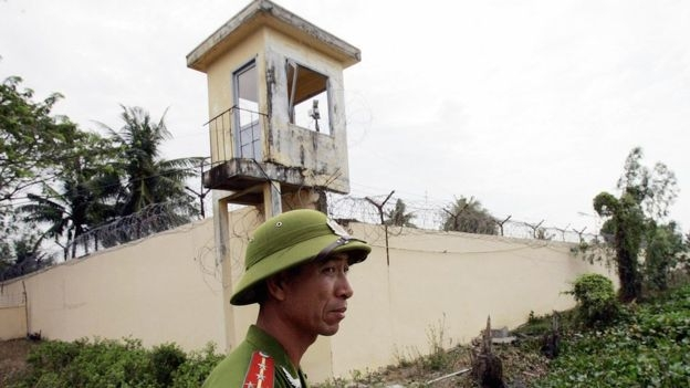 A Vietnamese policeman stands watch outside the Phuoc Co jail on the outskirts of the southern coastal town of Vung Tau