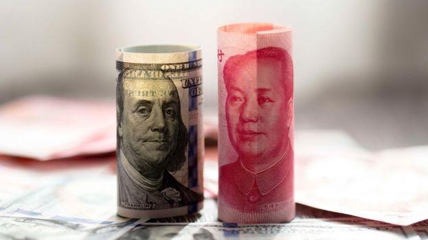 Trong cuộc thương chiến Mỹ - Trung, đồng NDT đã mất giá chừng 8% so với đồng USD.