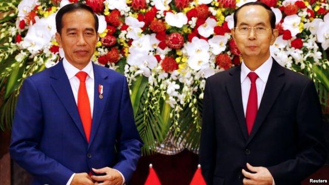 Ông Trần Đại Quang tiếp đón Tổng thống Indonesia Joko Widodo tại Hà Nội hôm 11/9.